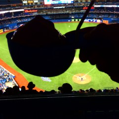Soft serve in a souvenir baseball cap.