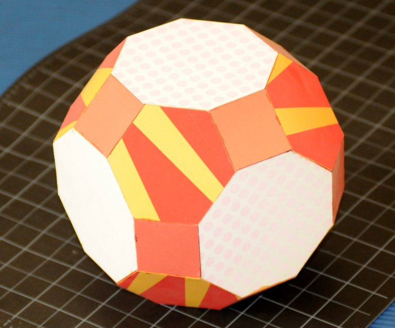 """Paper model of the """"Rhombitruncated Cuboctahedron"""" polyhedra, featuring 6 octahedron faces, 8 hexagon faces, and 12 square faces"""