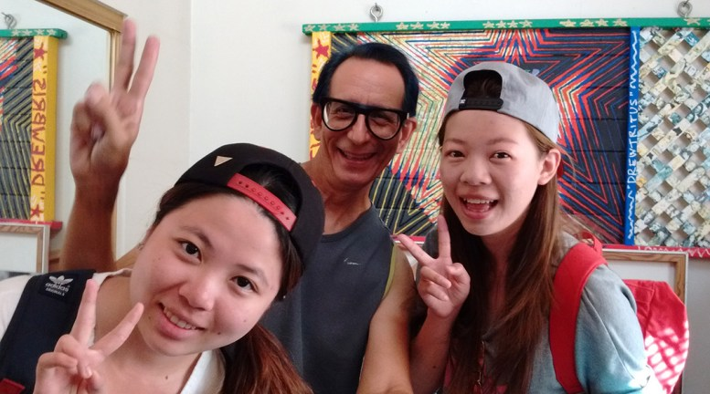 "Angel, Glenn & RuRu taking a selfie in Glenn's print room and flashing the familiar Asian ""V Sign"""
