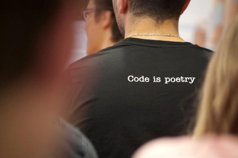 """photo of a guy in a """"Code is Poetry"""" t-shirt"""