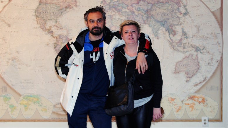 Michael & Maya from Croatia standing in front of a large world map