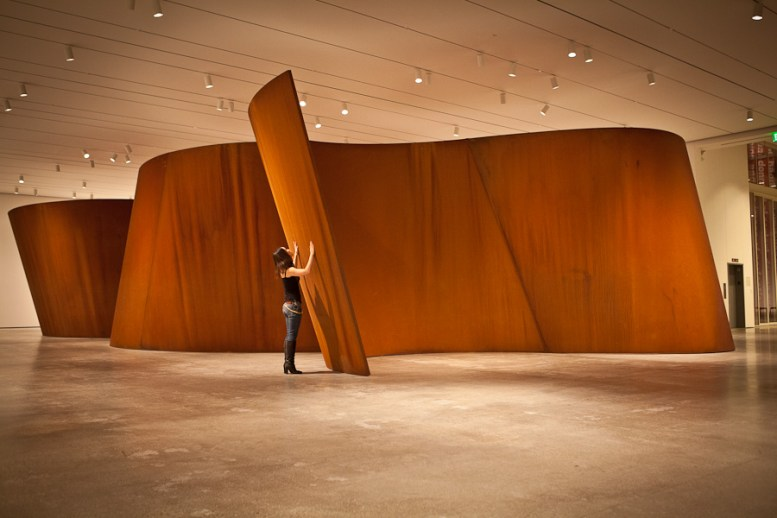 Serena Yang experiencing Richard Serra's _Band_ at The Broad Contemporary Art Museum in Los Angeles