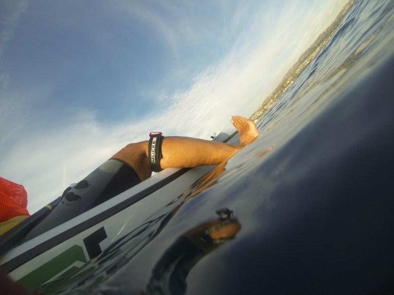 my (Glenn Zucman) foot sticking off a Fenn Surf Ski in calm autumn waters in the Pacific Ocean off the Newport Jetty in Newport Beach California