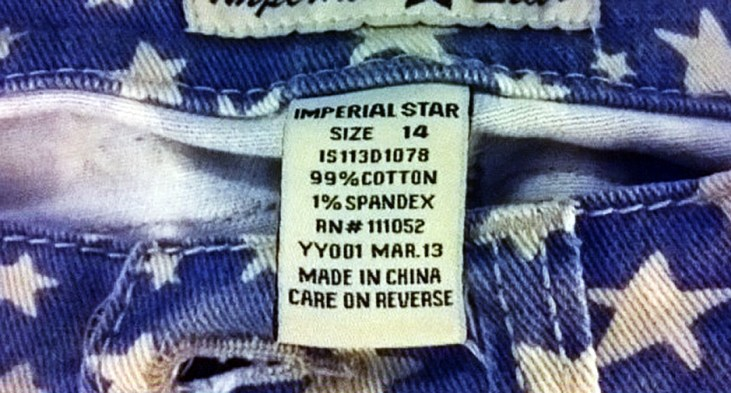 """photo of denim cutoffs with a USA flag pattern and a """"Made in China"""" label"""