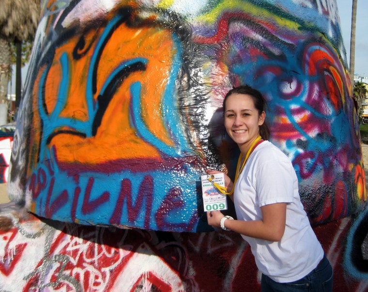 Jessica Harrington in front of the Venice Beach, CA Art Walls showing her painting permit