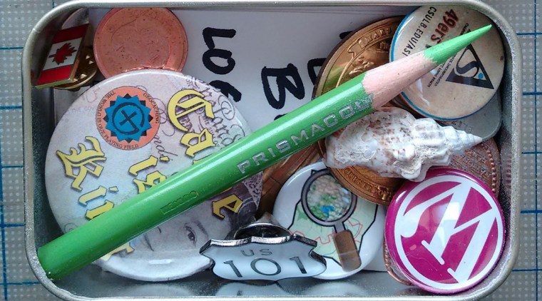 photograph of trinkets inside an Altoids tin