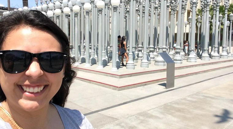 Cherry Mendoza in front of the Chris Burden Streetlight installation at LACMA