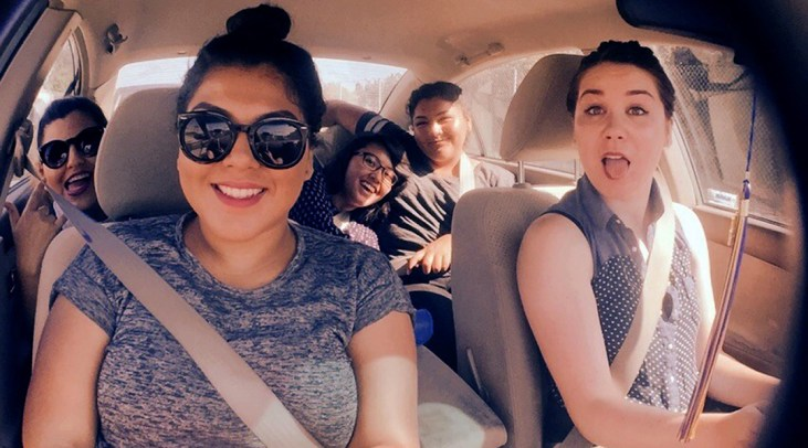 Photo of Stephanie Mejia, Diana Martinez, Anna Joy Floresca, C-Dawg & Allison Wendell riding in a car on their way to a Graffiti Writing Activity at the Venice Beach Legal Art Walls