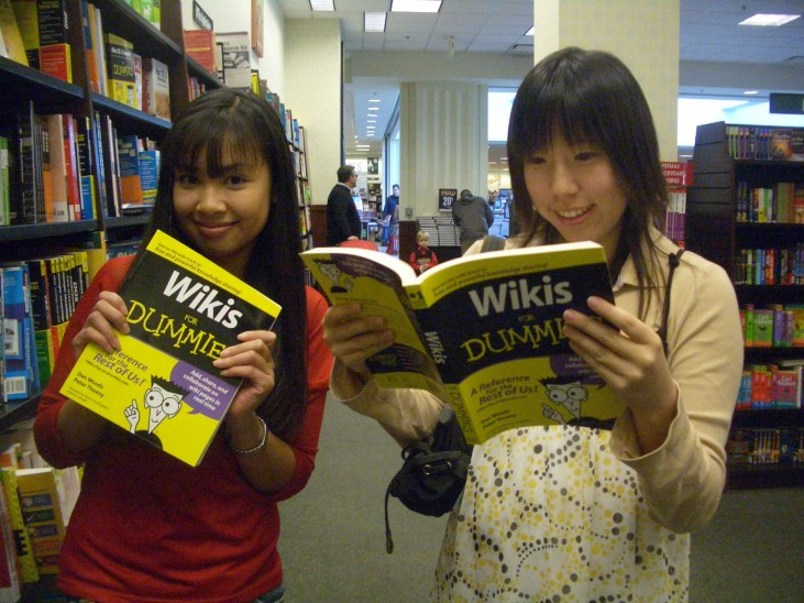 Lee Le & Joan Park looking at books in a bookstore
