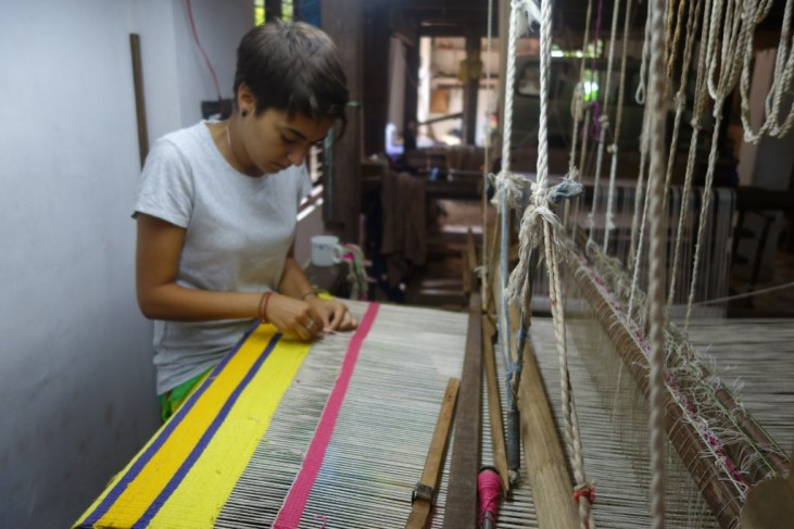 Marta Troya working at a loom in India