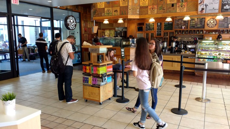 photo of students walking through the Robek's / Coffee Bean & Tea Leaf lobby at the California State University, Long Beach, University Student Union