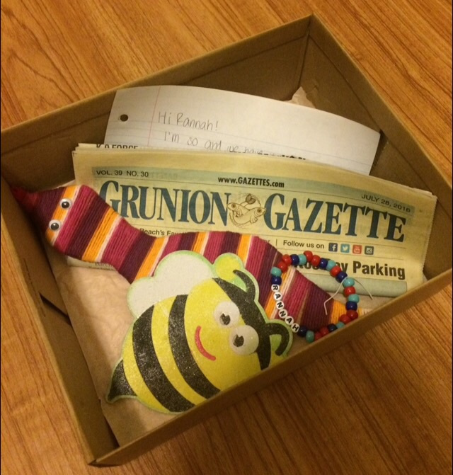 a box filled with various bits of ephemera including a hand-written letter