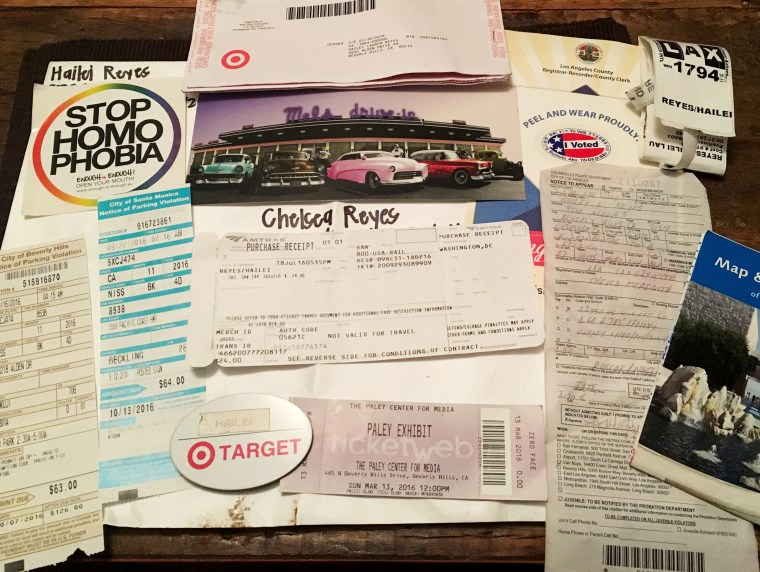 a collection of ephemera of life in Los Angeles, parking tickets, Target name badge, etc