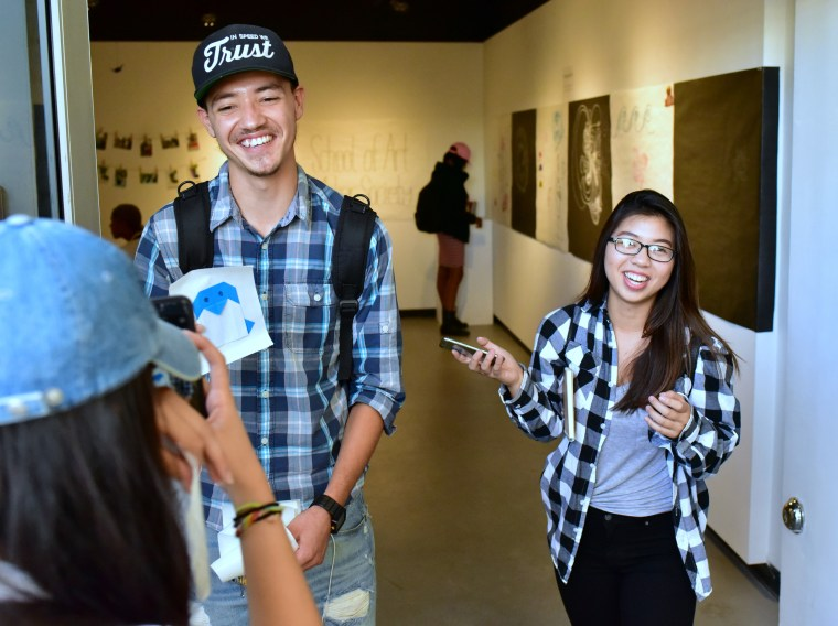 Introduction to the Visual Arts students walking through the School of Art Galleries