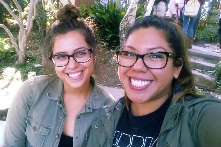 2 students smiling & posing for a selfie inside the CSU Long Beach, Earl Burns Miller Japanese Garden, Long Beach, California