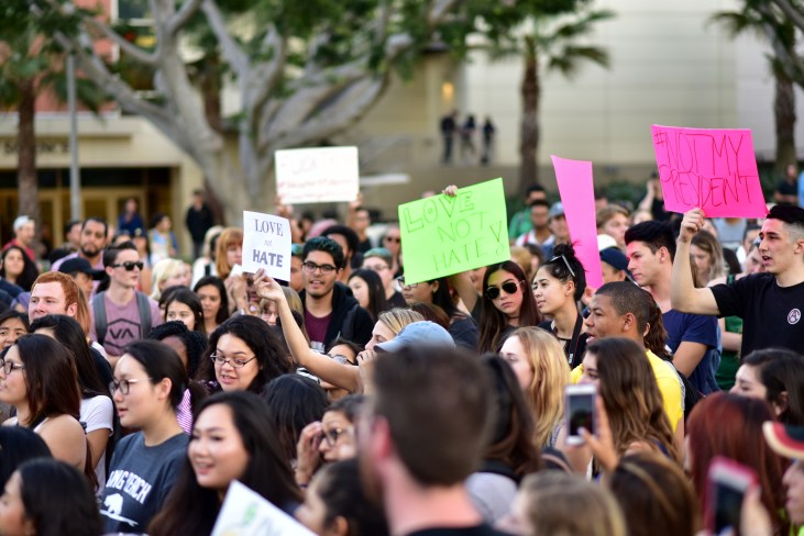 a few hundred CSU Long Beach students participating in a #NotMyPresident rally at the Free Speech Area at the north end of the campus mall