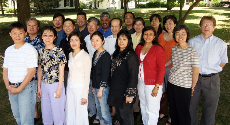 18 Asians and 1 Caucasian standing for a group photo