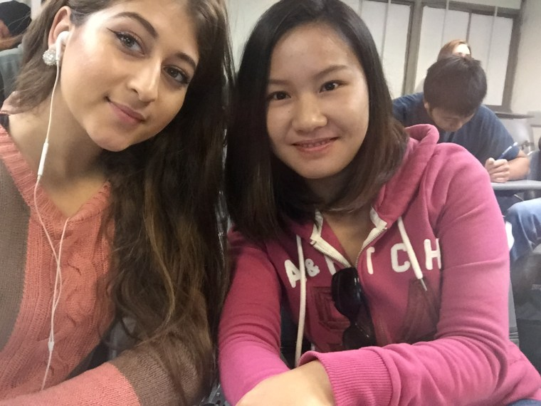 Lourdes Sandoval & Ruiwen Lin posing for a selfie in CSULB classroom FA4-311