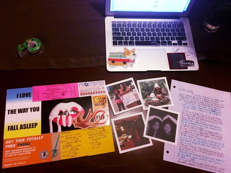 photo of a laptop, hand-written letter, and bits of ephemera