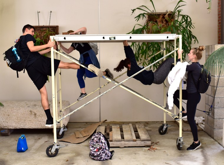 Antonella Redekosky, Kathryn Giometti, Makenna LaFortune, Nathan Moreno & Toria Painter improvising on a small scaffolding in the Long Beach State University, College of the Arts, School of Art, Art Gallery Courtyard on a sunny, windy, crisp and cold Wednesday afternoon in the first days of Spring 2017