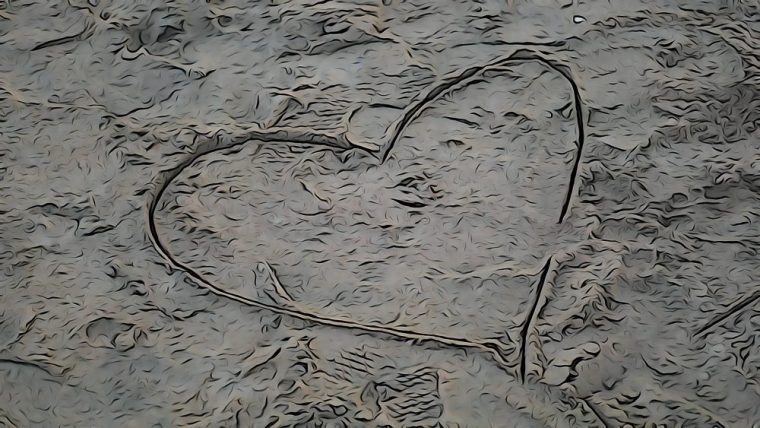 a heart drawn in the sand at the Seal Beach Pier