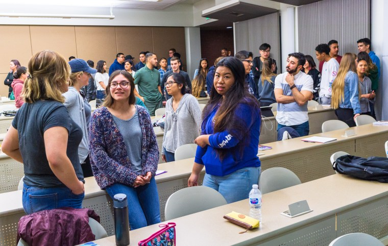 students in conversation in the MM-200 Classroom at Long Beach State University