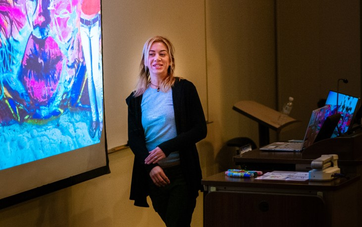 Artist Lizzie Green presenting a talk on her work
