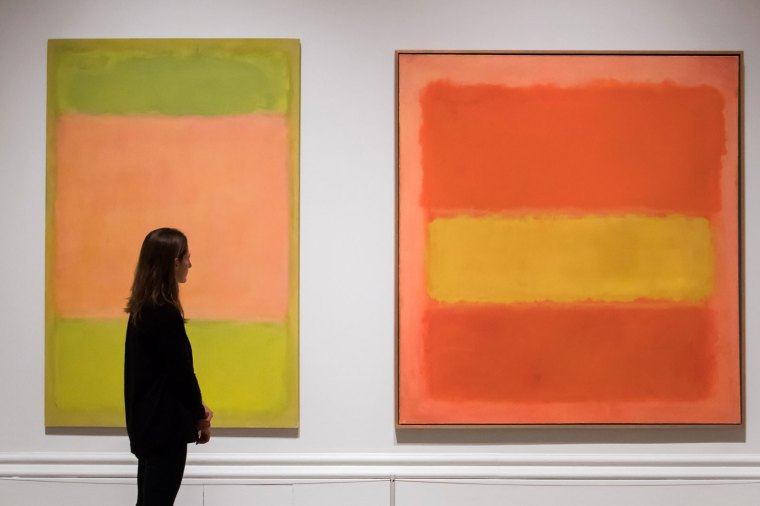 a person viewing two Mark Rothko paintings