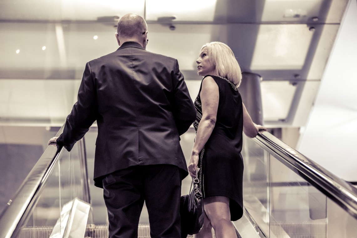 two people on the escalator