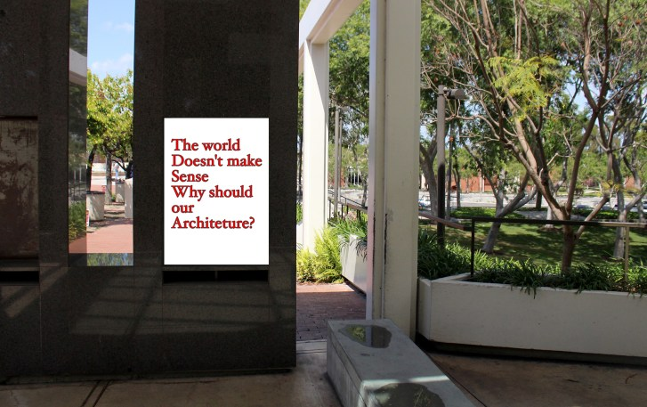 "The Wedge with a poster added. The poster reads, ""The world doesn't make sense, why should our architecture?"""