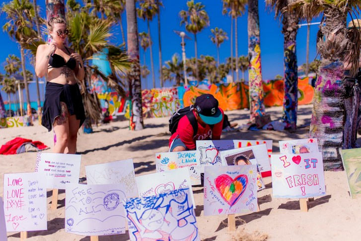 "visitors making ""Love Signs"" at Love Beach at Venice Beach, CA"