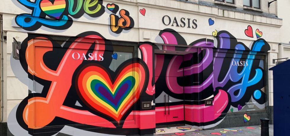 Pride decorated store front of an Oasis fashion store