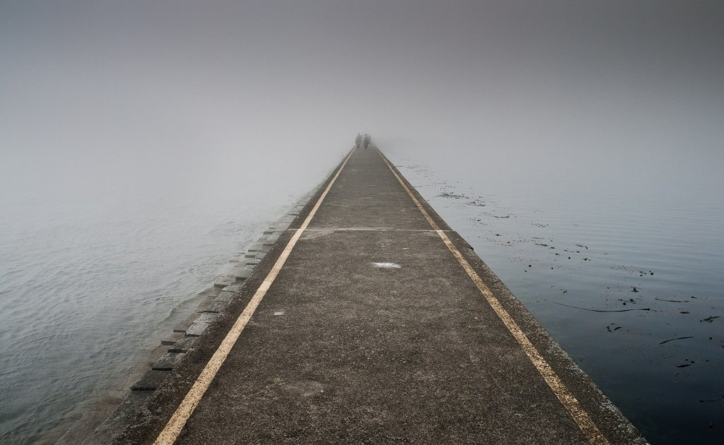 Jetty, fog, figures in the distance