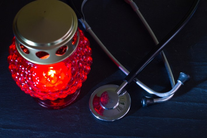 Stethoscope and Cemetary Candle