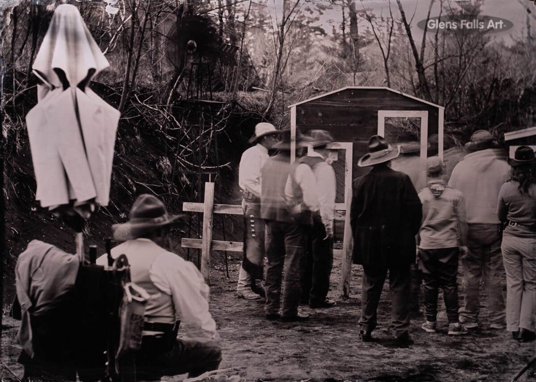fine art tintype of cowboys walking with gun carts made by photographer craig murphy in ballston spa ny