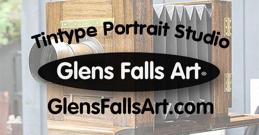 Official logo of Glens Falls Art tintype studio logo and the words tintype portrait studio and glensfallsart.com over a vintage camera.
