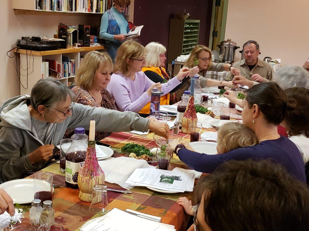 Seder attendees dip the parsley in salt water, representing tears.