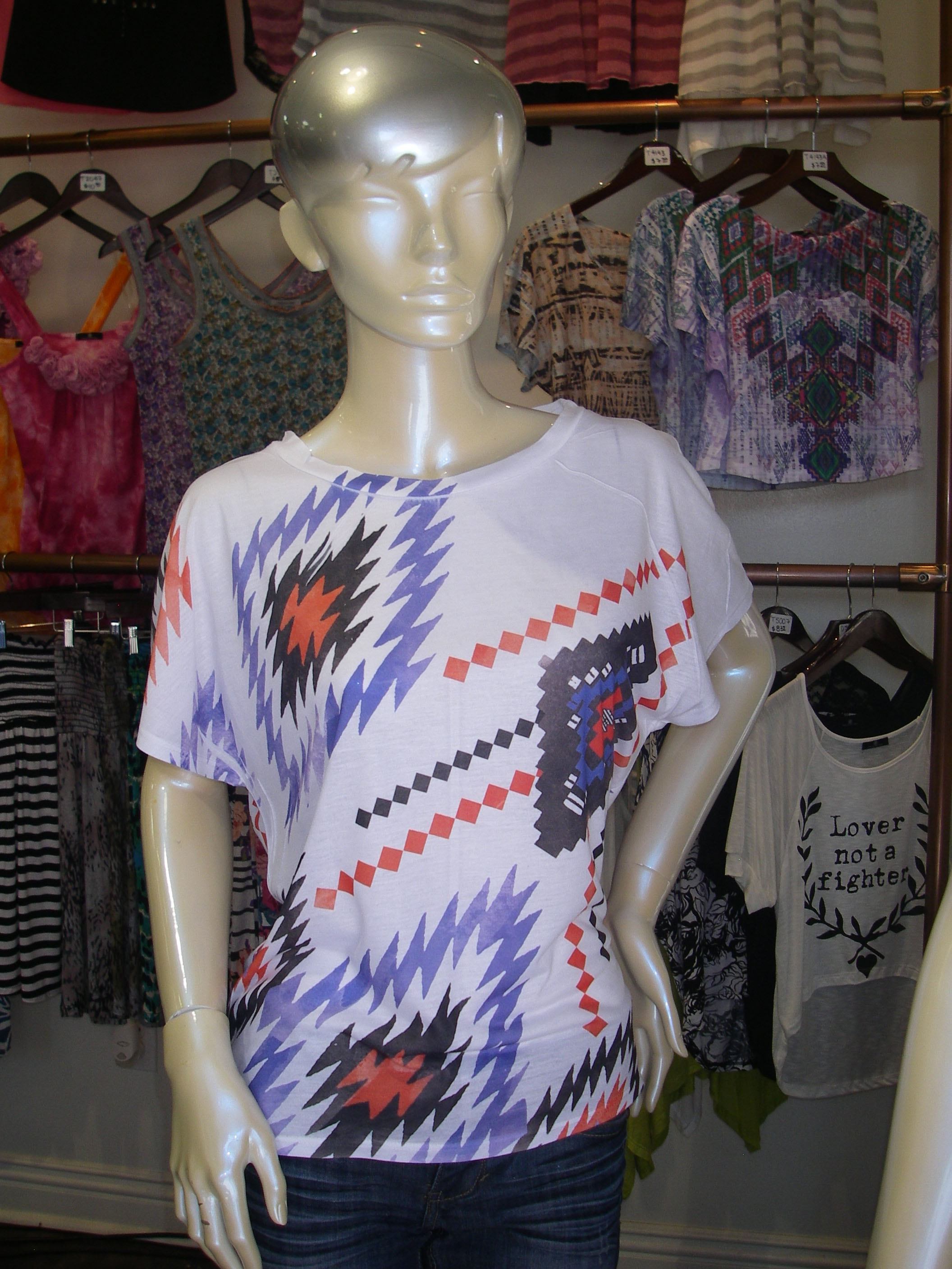 7ab4f059ab3 This great shirt from Valentine looks great paired with jeans and a chic  Boho bag for a day at the mall.
