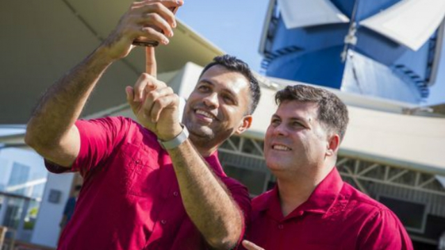 In a first, same-sex couple legally marries at sea on a cruise ship via TomCrewMember