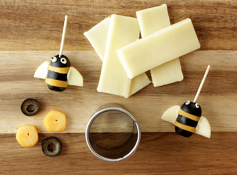 A fun snack recipe for cheese and olive bumble bees by Glitter and Bubbles.