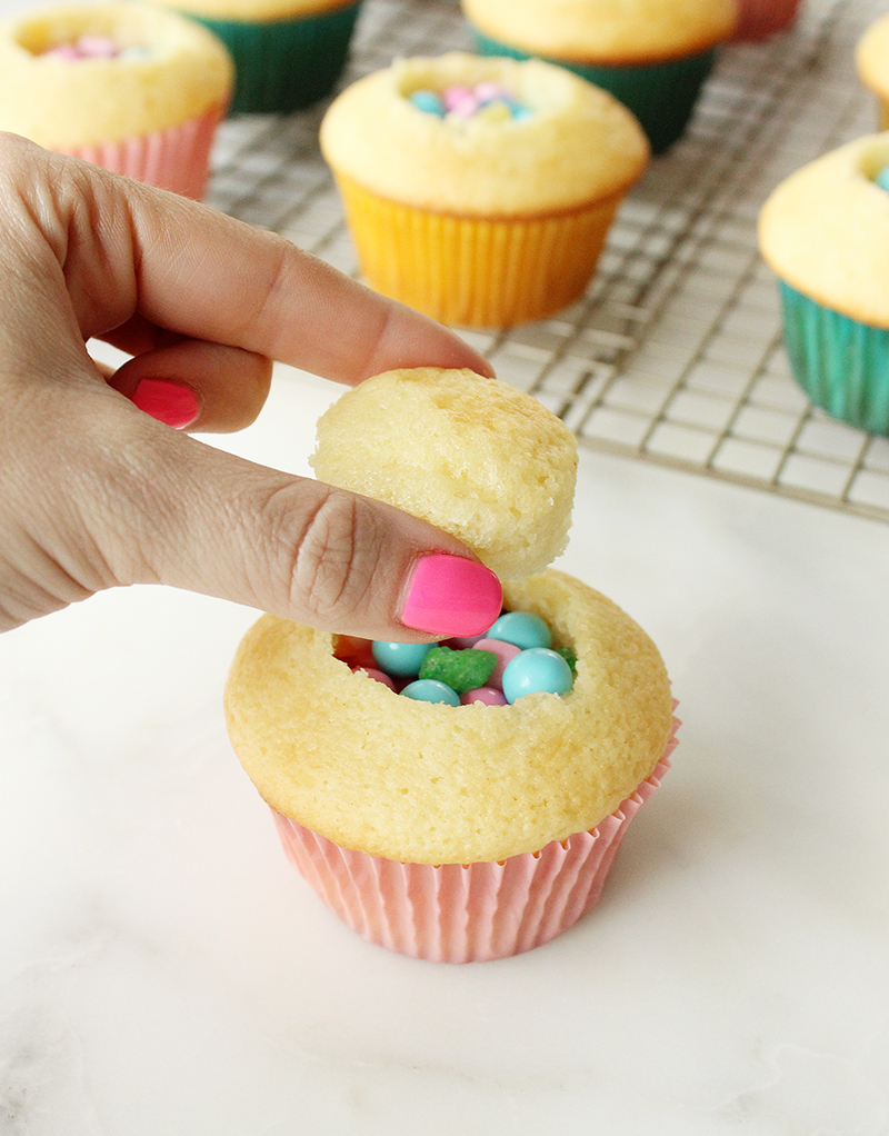 This is a recipe for Sugarwish Piñata Cupcakes by Glitter and Bubbles.