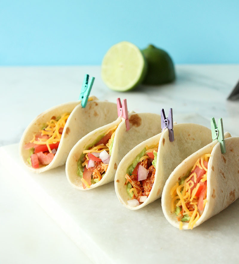 This is a recipe for Mini Shredded Chicken Tacos using the Crockpot by Glitter and Bubbles.