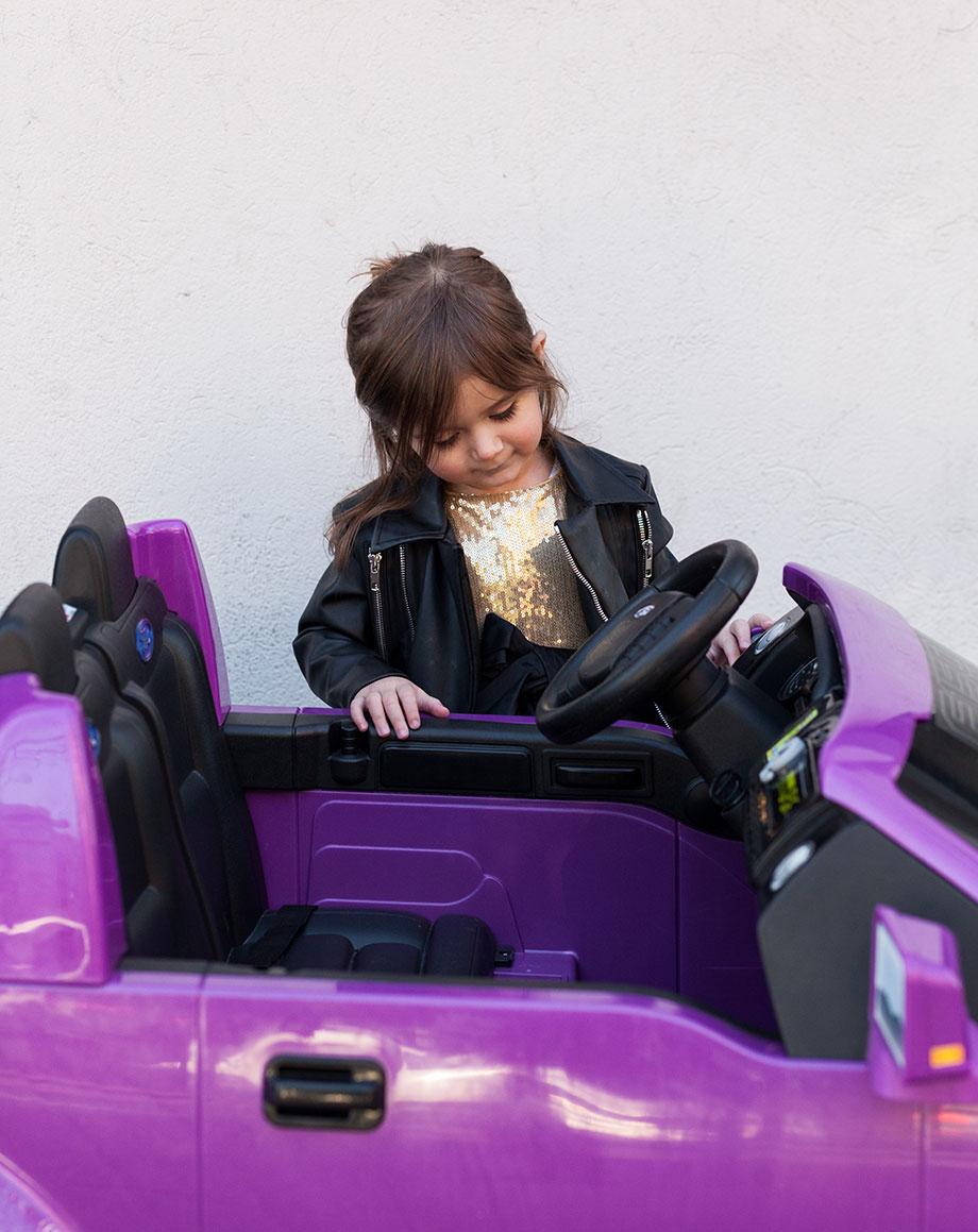 A purple F150 ride on car from Walmart.