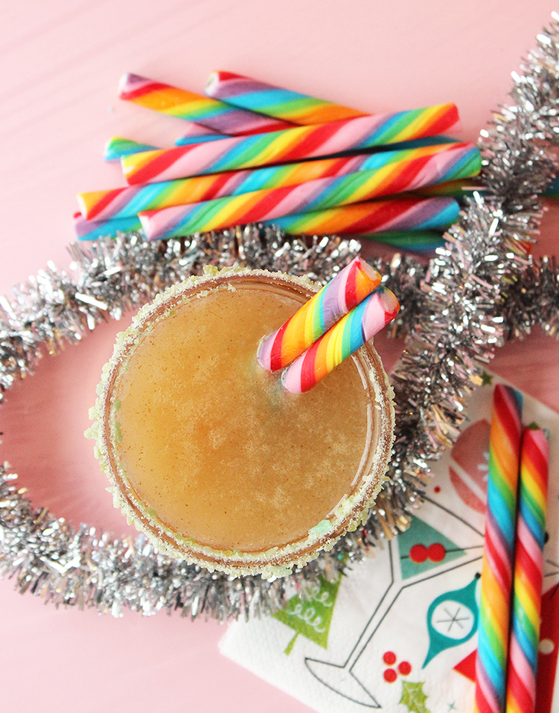 A pear and lemon mocktail with a Pop Rocks rim and rainbow candy.