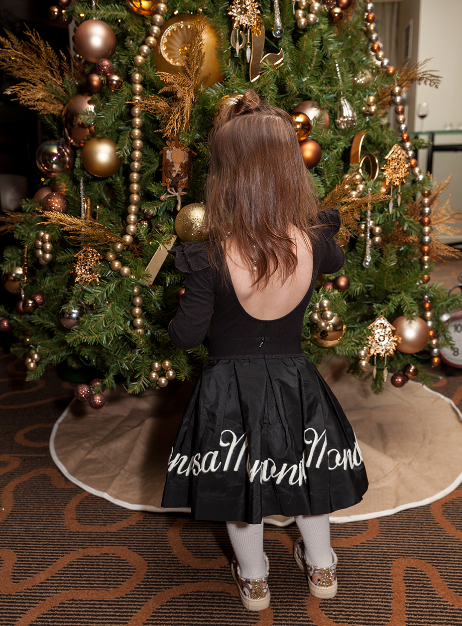 A little girl looks at a Christmas tree at the Swissotel.