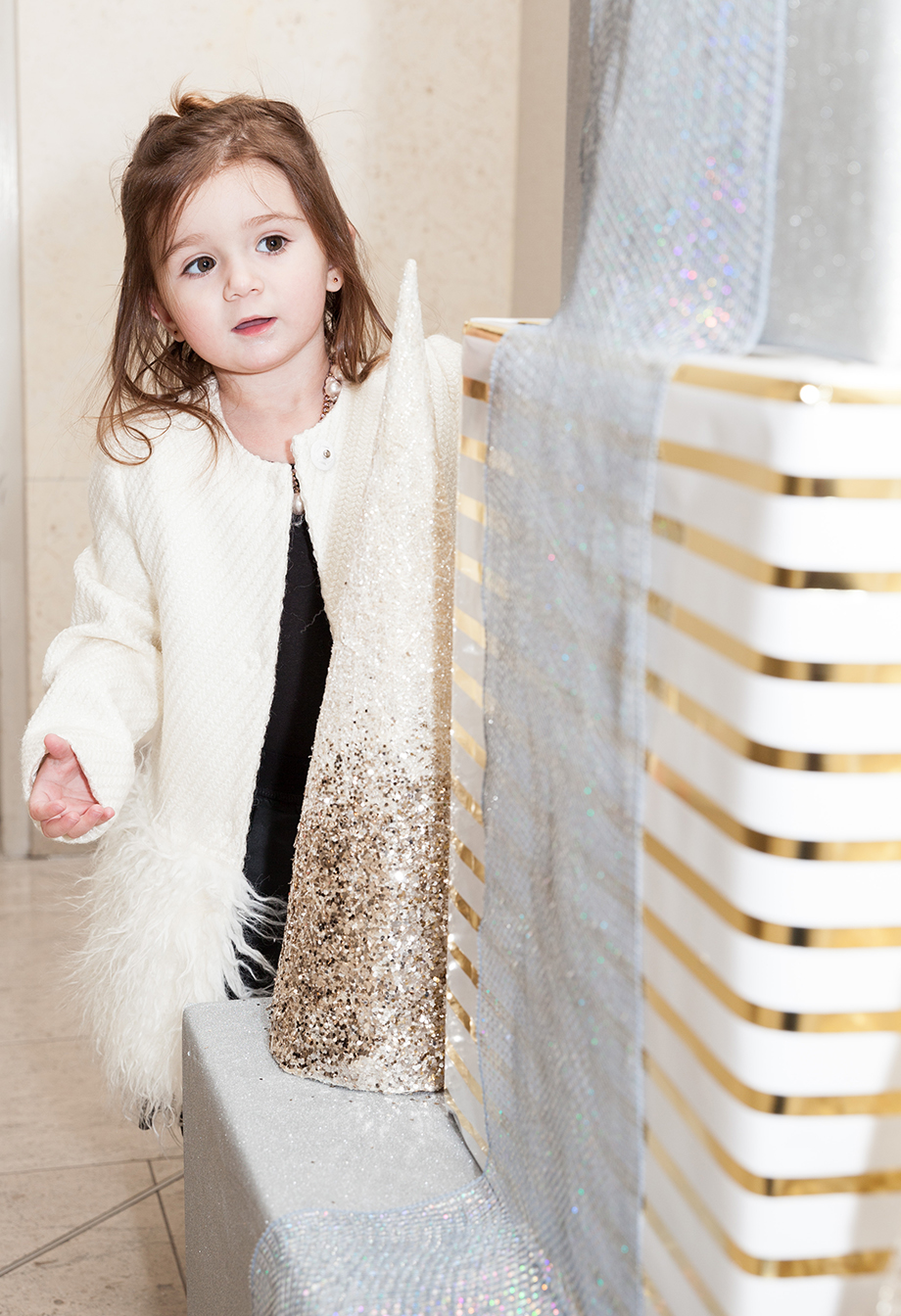 A white feather Mona Lisa coat at the Santa Suite at the Swissotel.