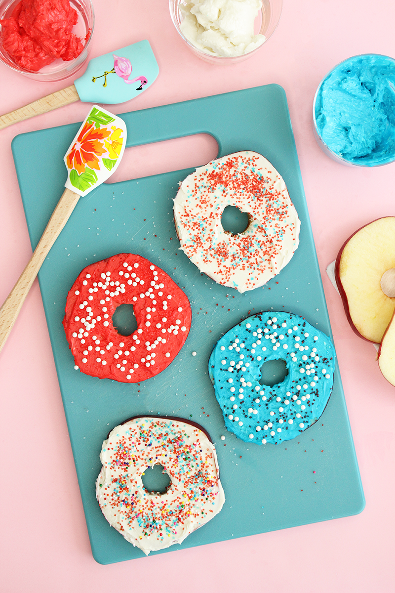 Memorial Day red, white and blue apple donuts with cream cheese frosting.