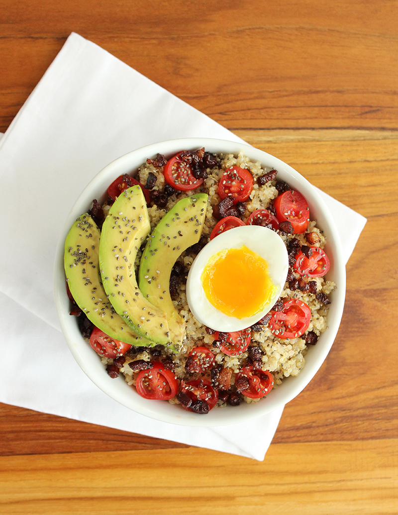 A delicious quinoa breakfast bowl filled with veggies for breakfast.