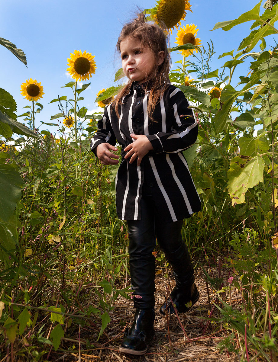 Black and white girls top in a sunflower field for Burning Man.