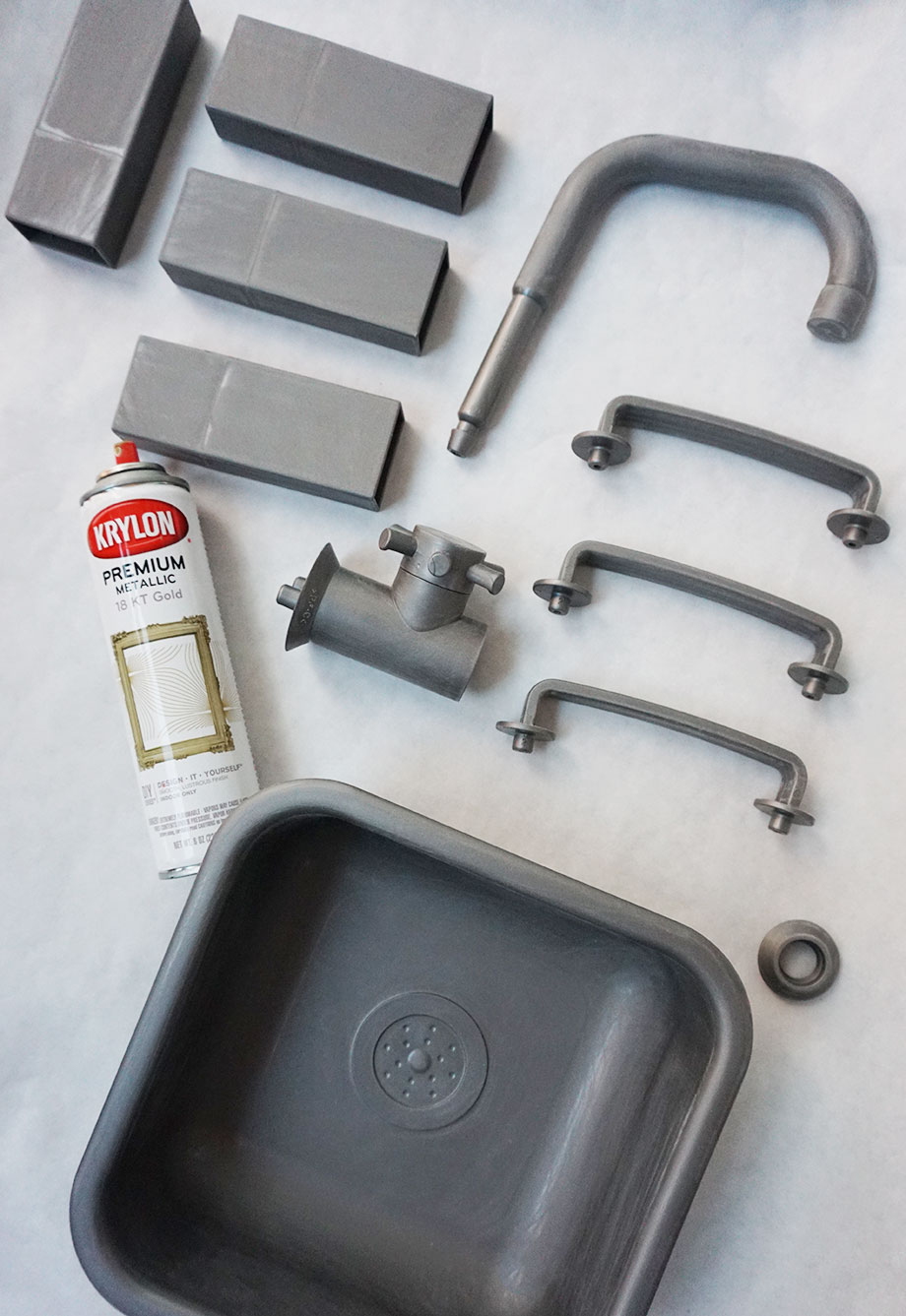 Spray paint the kitchen fixtures for an epic IKEA hack.